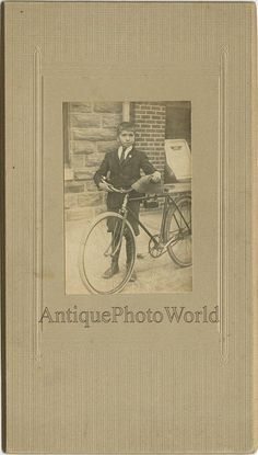 Proud boy with great bicycle antique toy photo