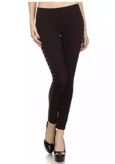 Solid black leggings with cross shaped stud