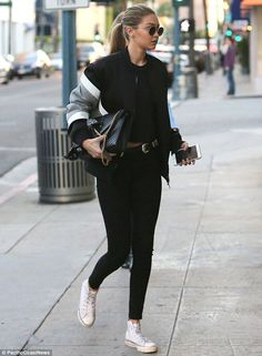Taylor Swift looks serious after manicure session with Gigi Hadid after intruder was caught at her LA home | Daily Mail Online