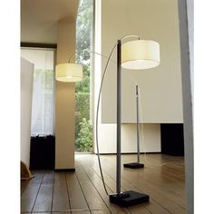 'Mama' Floor lamp with counterbalance-controlled arm. Structure in brilliant-chromed tubular steel with varnished stained concrete base and white or black taffeta shade. Supplied with 1 x E 27 - 20 W compact fluo globe bulb, Ø 90 colour 827. The above-mentioned dimensions relate to the arm in 'open' position; when 'closed', the overall dimensions are H164 W40 D67cm. When in 'closed' position it is a floor standard lamp, whilst in 'open' position it can be used to illuminate the top of a…