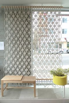 Macrame curtain...really neat. This would be really pretty as a canopy or hanging from a crown