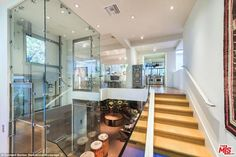Avoic the stairs: A glass elevator in the center of the home services each floor...