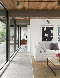 """A 1957 Midcentury in Seattle Receives a Striking Makeover - Photo 7 of 16 - In the family room, """"short ribbon windows were replaced with a wall of glass"""" for a effortless indoor/outdoor flow. House Design, Family Living Room Design, Room Design, House Interior, Home, Design, Family Room, Modern Renovation, Home Decor"""