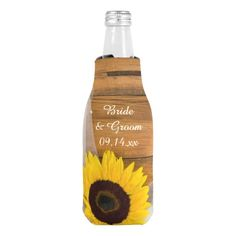 #Sunflower and Veil Country #Wedding Bottle #Cooler Keep your bottles cool with the charming Sunflower and Veil Country Wedding Bottle Cooler. Personalize it to create one of a kind wedding, shower or party favors. This shabby chic custom bottle cooler features a yellow sunflower and bridal veil with a barn wood background. Perfect for the cold bottled beverages of your casual yet classy rural country farm, rustic barn, ranch or western wedding theme. #weddingfavors #barnwedding #favors…