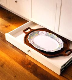 Brilliant solution for serving platters that are not used that often:  Build shallow drawers into the toe-kick spaces (those 3- or 4-inch spaces below base cabinets) in your kitchen or bath. Outfit each drawer with a touch-latch release so you can easily open it with a light tap of your toe.#storage, #kitchen