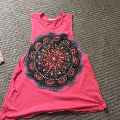 Hot pink graphic tee Big graphic tee usually goes with leggings. Has very low sides. From urban outfitters Urban Outfitters Tops Tank Tops
