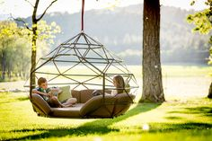 Structural engineer Richie Duncan designed the 'Kodama Zomes', hanging geodesic domes for lulling through the summer.