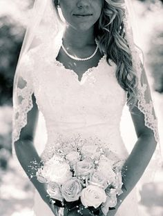 lace veil, pearls, and a modest sweetheart... IN LOVE with this dress!! Seriously it's absolutely stunning!