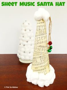 Sheet Music Santa Hat using a Styrofoam cone, sheet music, cotton balls and some jingle bells as a finish touch!