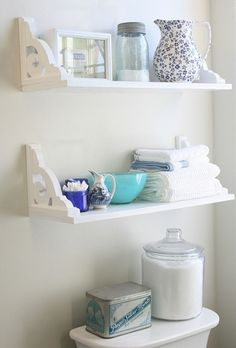 I kind of like the upside-down shelving for in a bathroom... looks cute with those brackets and makes sense so things are less likely to fall.