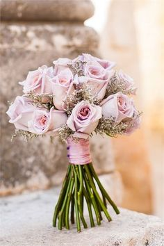 Gorgeous lilac rose bridal bouquet filled with natural heather, long stemmed and tied with lilac ribbon, this pretty arrangement would be wonderful at a vintage wedding.