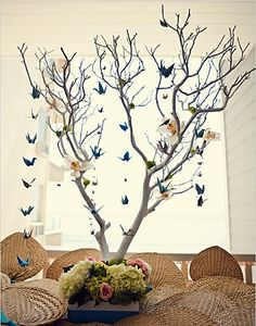 Origami birds and tree branch centerpiece