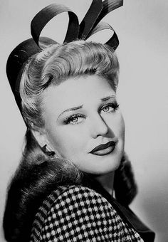Ginger Rogers rocking houndstooth and a sculptural hat, 1940s. #vintage #actresses #fashion