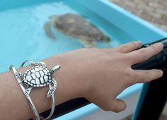 Celebrate the majesty and mystery of the sea turtle with this sterling silver bracelet. The bracelet features a beautiful sea turtle set on top. It is pretty and playful enough for everyday, yet elegant enough for evening. The bracelet is expandable for any size wrist.     *Price Includes Shipping (We can only accept orders for U.S. shipping at this time, please check back for updates, thank you)   #seaturtle #bracelet #silver #gorgeous #armcandy #botd #seaturtles #jewelry $25