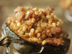 Stuffed Acorn Squash with Sausage, Barley and Goat Cheese recipe from Damaris Phillips via Food Network