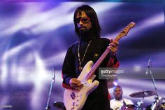 American musician Prince wears a wig, sunglasses, and a false goatee as a disguise with the opening act of The 10th Anniversary Essence Music Festival on July 2, 2004 in New Orleans, Louisiana.