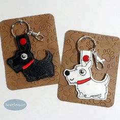 Black or White Scottie Dog, Westie Terrier Key Fobs or Purse Charms: This adorable key fob is perfect for terrier lovers! Made of vinyl and secured with a metal snap, includes a split key ring and optional swivel lobster clasp so you can attach it to your key ring or purse. Arrives gift ready, mounted on a hand-stamped, embossed card and wrapped in a 4 x 6 inch clear bag. @sewamazin