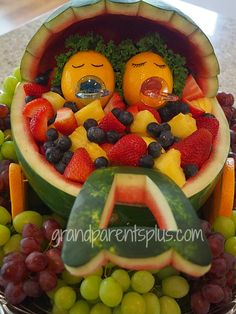 Fruit Salad for a baby shower! Baby buggy from a watermelon and babies from lemons with curly leaf lettuce for hair!