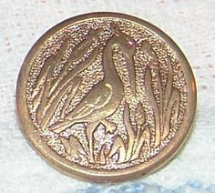 Graceful Antique Stamped Gold Gilt Brass Button Heron Bird Button Standing on 1 Leg in the Reeds and Water Paris Back Mark Loud & Cie True Serenity! Measures 5/8 Paris Back Mark, Gold Gilt Brass Loop Shank Circa 1880 Excellent Condition Very Little Wear and Darkening. Still Very Bright and Clear!  Great for Collecting, Reenactment, Sewing, Jewelry, Art and MORE!  Thank you for stopping by and having a look