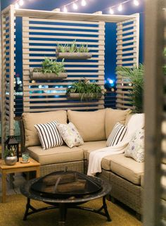 Cozy & Comfortable Outdoor Space. DIY Privacy Screen with succulent wall garden. Weathered gray sectional from Allen & Roth.