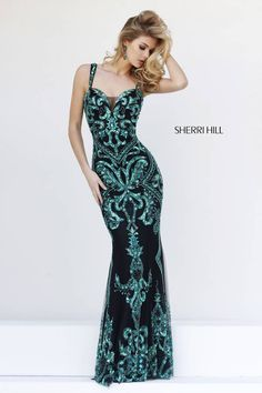 Exude gorgeous glamour in the show stopping Sherri Hill 9751 full-length dress. This sleeveless black gown is intricately embellished with stunning emerald beads, creating a luxuriant display. The bodice showcases a plunging sweetheart neckline with sheer modesty inset. Beaded shoulder straps embrace the straight, semi-open back. This dress makes a mesmerizing sheath silhouette.