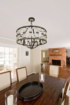 This 1st floor re-design was for a newly-wed couple who recently purchased a home. They wanted to make the house their own by incorporating a bar area, and opening up the living room and dining area for entertaining.