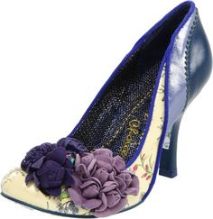I love these! They are designed by a company called Irregular Choice. They do fabulous shoes that are more works of art than fashion items.