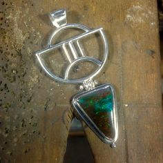 Boulder opal and hand fabricated silver pendant by Gecko Skin Jewellery.