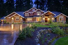 Beautiful exterior lighting. Love that this house is right on the water.