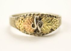 Vintage Leaf Ring Sterling Silver Black Hills Gold Diamond Cut Two Leaf Ring. $45.00, via Etsy. @Thepickingpair