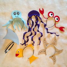 6 ocean creatures headbands in any color desired! This set comes with an octopus, crab, shark fin, fish, starfish, and jellyfish headbands. You can also pick and choose the desired quantity of each sea creature and mix and match. Please mention the desired colors in the order notes before checking out. Great for the guests to wear at the party or give out with the invitations. One size fits all: babies, children and adults. Headbands are very comfortable for all to wear! We often forget we…