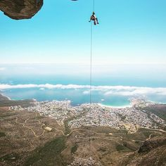 C4 director @timkemple photo // Easiest crag access ever? Certainly one of the most scenic rappels on the planet. #CapeTown #tablemountain #camp4pix