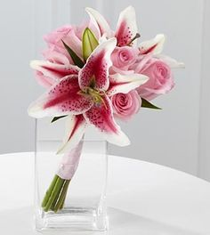 The FTD® Spirit of Love™ Bouquet is a striking representation of love's most eloquent expressions. Stargazer lilies and soft pink roses are gorgeously hand-tied together and paired with a clear glass