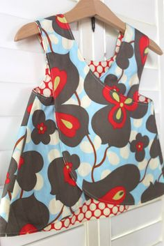 Crossover apron/top/art apron. For girls can make longer and with legging have a cute dress, for boys use a rugged fabric and it will be great for being in the dirt too.