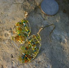 Items similar to Abstract Leaf Gold Wire Wrapped Multi Colored Beaded Drop Earrings on Etsy