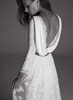 Romantic floral embroidered two piece draped back wedding dress; Featured Dress: Rime Arodaky