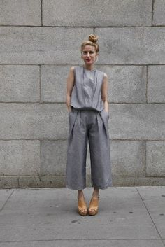 The grey smart look - three quarter length grey trousers with a loose satin grey top - perfect for a chic night out. Take this outfit from day to night • For more creative, fashion & beauty follow me on Pinterest at The Happy Flat.