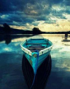 Blue boat, water, sky