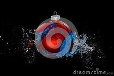 A red babule bursts open, splashing around blue water