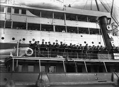 April 1912: Survivors of the 'Titanic' disaster on board a tug, arriving at Plymouth.
