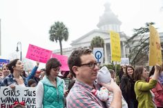 COLUMBIA, SC - JANUARY 21: Demonstrators participate in the March In Defense of Women's Rights at the South Carolina Statehouse January 21, 2017 in Columbia, South Carolina. The event was one of hundreds of rallies and marches in more than 20 different countries inspired by the Women's March in the nation's capital. (Photo by Sean Rayford/Getty Images)