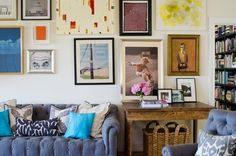 Fashion Designer Minnie Mortimer Lists Her Stunning Nantucket-Style LA Home // gallery wall, blue tufted sofa, skateboard photograpy