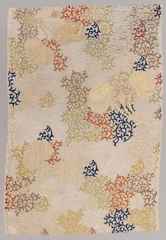 Japan | Length of silk (karaori) for use in a Buddhist priest's robe (kesa) with design of leaves and floral arabesques in purple, reddish-orange, blue, and green silk and gilt paper strip supplementary weft patterning on a creme twill-weave silk ground.