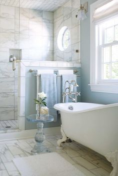 The Best White Bathrooms...Maria Killam Love the towel rail and colour of the white and grey tiles on the wall