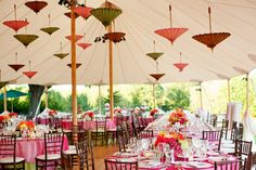 Umbrellas as decor in the tent - awesome splash of clor