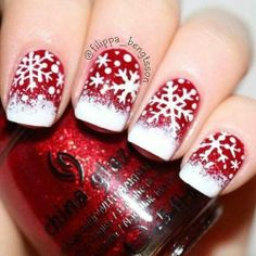 Red and white Christmas snow flake themed nails