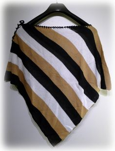 Handwoven Poncho A lightweight layering piece, crafted with its own flair, perfect for sheltering in an autumn or wintery weather.