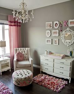 Asha's- picture frames on the wall, chandelier, chair