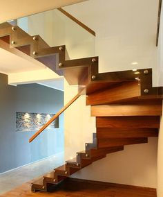 Zigzag stair made of Amazaque wood. Balustrade of tempered glass with wooden handrail. Stairs of the TECHNE line. Private residential project, designed by TRĄBCZYŃSKI. Circle Stairs, Spiral Staircase, Joinery, Carpentry, Zig Zag, Teak, Projects To Try, Interior Design, Gallery