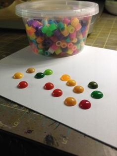 To create enamel dots use Perler beads. Place them on your baking sheet, you can cut them in half to make smaller dots. I bake them at 110degC for about 15 minutes.
